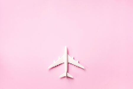 Top view of white model plane, airplane toy on pink pastel background. Flat lay with copy space. Trip or travel banner. Stok Fotoğraf