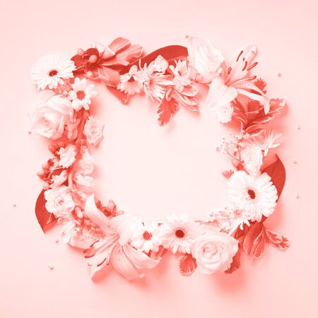 White roses, lily, gerbera over trendy coral background. Flat lay, top view. Creative layout. Spring or summer banner with copy space. Flowers composition. Living Coral color of the Year 2019 Stok Fotoğraf