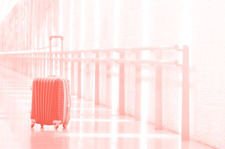 Packed travel suitcase, airport. Summer holiday and vacation concept. Traveler baggage, brown luggage in empty hall interior. Copy space.