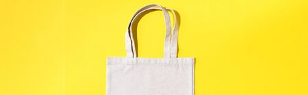 Reusable textile bag on yellow background. Zero waste concept with copy space. Zero waste, plastic free concept. Top view. Eco friendly mesh shopper. Banner 写真素材