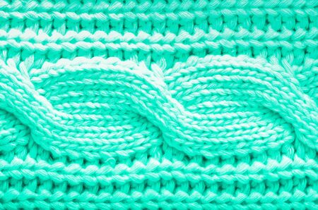 Knitted texture. Pattern fabric made of wool in mint color. Background, copy space. Trendy green and turquoise color Reklamní fotografie