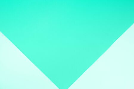 Background in trendy mint color. Fashionable mint paper. Top view. Minimal concept. Green color of the year 2020