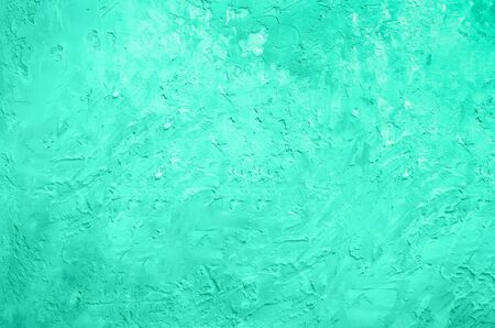 Abstract cement concrete background. Grunge texture, wallpaper. Trendy green and mint color. Top view, copy space. Banner.