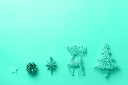 Silver Christmas decoration in mint color. Deer, fir-tree, stars, cone on monochrome background. Trendy green and turquoise color. Festive card for winter event, party. Banner. Imagens