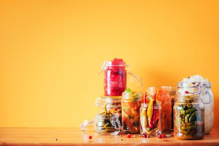 Probiotics food background. Korean carrot, kimchi, beetroot, sauerkraut, pickled cucumbers in glass jars. Winter fermented and canning food concept. Banner with copy space. 版權商用圖片