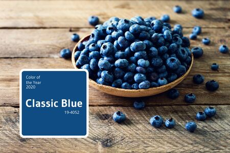 Blueberries on wooden table. Blueberry bowl on vintage background with copyspace. Berries frame, healthy food concept.