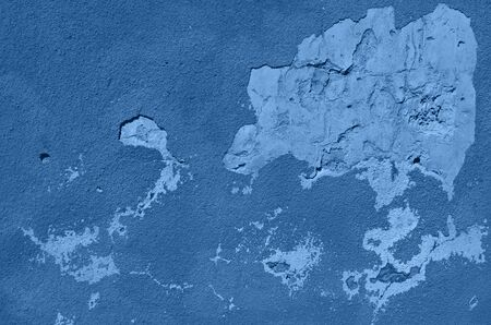 Old cracked calm wall. Painted texture background in monochrome color. Trendy blue and calm color. Banner. 版權商用圖片