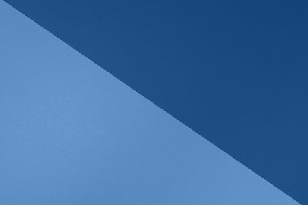 Background in trendy blue colors. Fashionable paper. Top view. Minimal concept. Trendy monochrome color. 写真素材