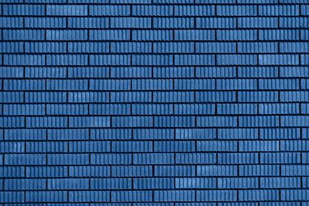 Textura de pared de ladrillo. Fondo con espacio de copia para el diseño. Color Verde Vizcaya del año 2020 Foto de archivo