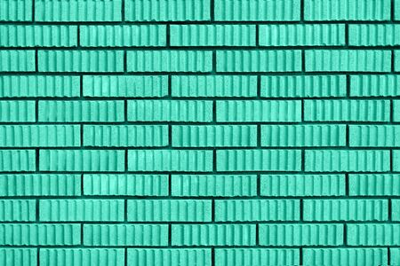 Brick wall texture. Background with copy space for design. Biscay Green color of the year 2020 Zdjęcie Seryjne