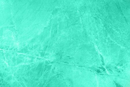 Mint marble texture. Natural patterned stone for background, copy space and design. Abstract marble stone surface. Trendy color. Tones of biscay green color.