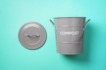 Recycling food waste bin for compost on blue background. Top view. Copy space. Sustainable and zero waste living