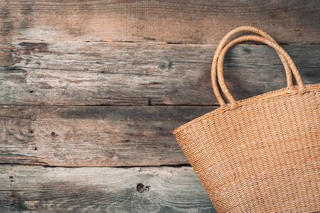 Handmade summer bag on wooden background. Top view. Fashionable stylish accessory. Natural, organic, eco friendly, zero waste, plastic free concept Banco de Imagens