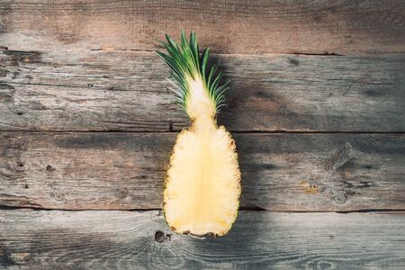 Creative layout made of pineapple on wooden background. Top view. Copy space. Flat lay. Exotic food, tropical fruit concept