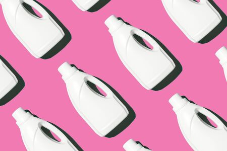 White plastic bottle of cleaning product, household chemicals or liquid laundry detergent on pink background. Creative design for packaging. Top view. Flat lay. Copy space. Detergent bottle pattern.