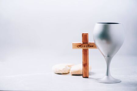 Communion still life. Unleavened bread, chalice of wine on grey background. Christian communion concept for reminder of Jesus sacrifice. Easter passover Zdjęcie Seryjne