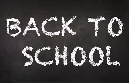 Back to School written with chalk on blackboard. 1st September concept. Chalboard inscription.