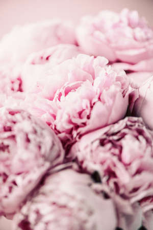 Wedding, birthday, anniversary bouquet. Pink peony flower on pastel background. Copy space. Trendy pastel floral composition. Woman day, Mothers day. Macro of peonies flowers