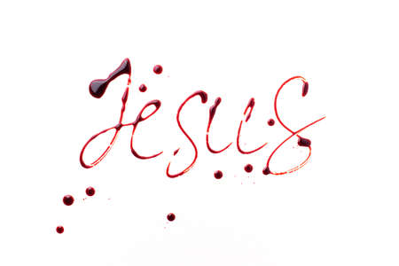 Name Jesus written with blood isolated on white background. Top view. Palm Sunday, Good Friday, Easter concept, Christ resurrection. Christianity symbol and faith.