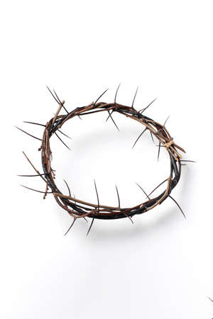 Crown of thorns isolated on white background. Top view. Copy space. Christian Easter concept. Crucifixion of Jesus Christ. He risen and alive. Jesus is the reason. Gospel, salvation
