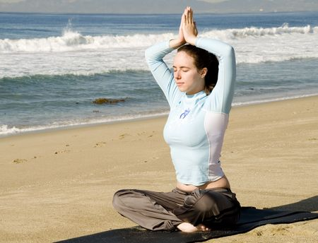 Pretty Girl in Yoga Meditation Pose at Beach Stock Photo - 6100485