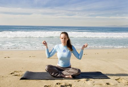 Pretty Girl Doing Yoga at the Beach Stock Photo - 6100486
