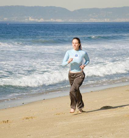 Girl Running at the Beach Stock Photo - 6100480