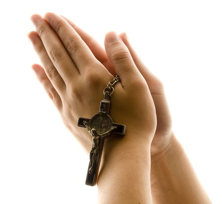 chirstmas: Hands in Prayer with Crucifix Stock Photo