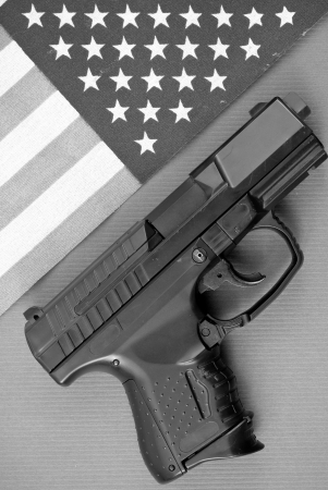 Black and White Image of Gun and Flag photo