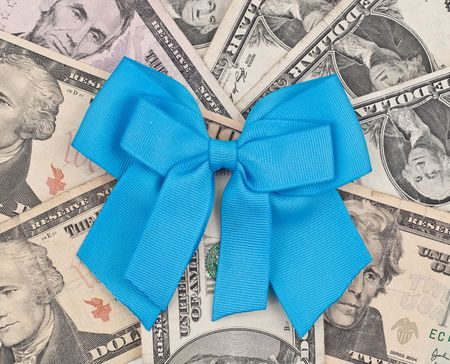 poverty relief: Blue Charity Ribbon on Pile of Money