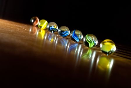Colorful Cat Eye Marbles with Single Point Lighting photo