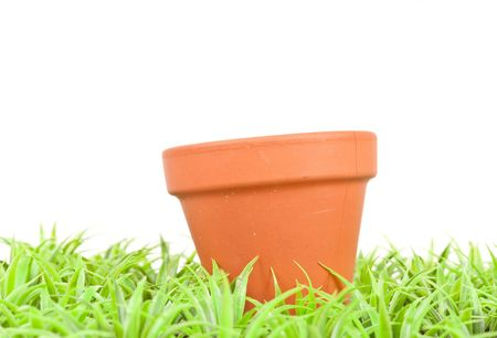 Empty Clay Pot in the Grass Stock Photo - 7885683