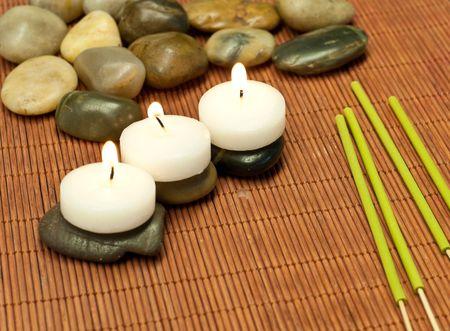 Three Tea Candles on Stones  Reklamní fotografie