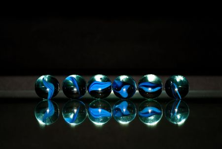 Row of Blue Marbles with Reflection on Glass photo