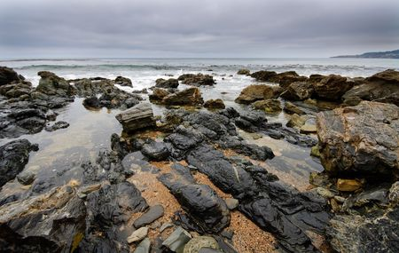 barnacles: Tide Pools on Beach Shoreline During Low Tide Stock Photo