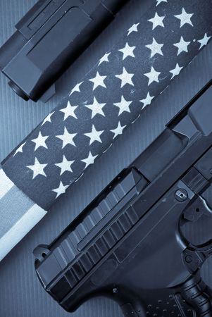 American Flag in Blue Filter with Hand Guns photo