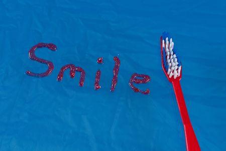 Smile Written in Toothpaste Next to Toothbrush Stock Photo - 8017066
