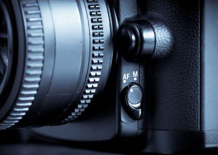 Auto Focus/Manual Override Switch on Digital SLR Camera Stock Photo - 8079003
