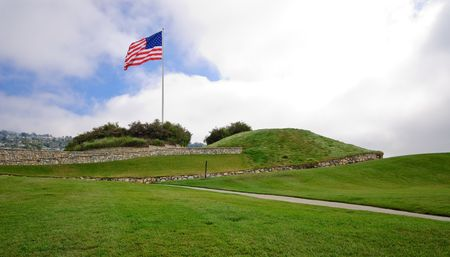 golf of california: Golf Course Grass Hills with Large Flag