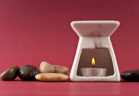 eastern health treatment: Candle In Oil Burner Stock Photo