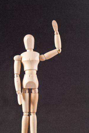 Wooden Doll Waving Hello photo