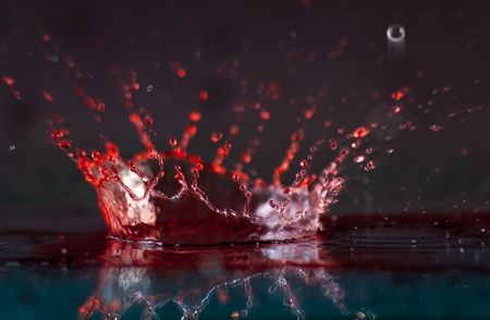 clean blood: Close Up of Red and Clear Liquid Splash Crown
