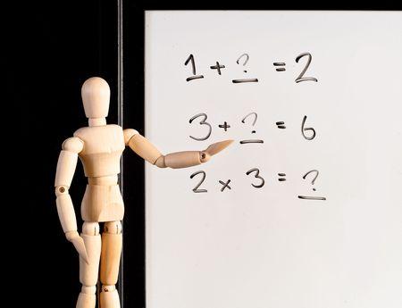 wooden mannequin: Wood Doll Teaching Basic Math Stock Photo