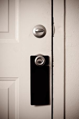 Blank Black Door Sign on Door Handle photo