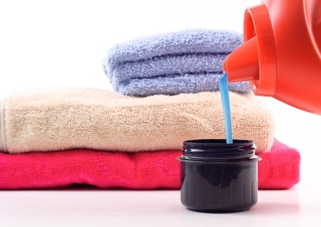 Laundry Detergent Pouring Into Measuring Cap Stock Photo - 8484384