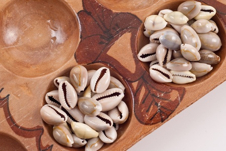 Pods Filled with Shells on Mancala Game Board photo