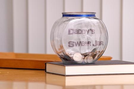 swear: Daddys Swear Jar Stock Photo