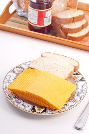 Slices of Cheddar Cheese with Bread on Plate photo