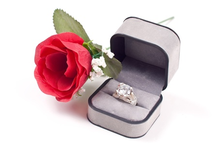 Diamond Engagement Ring in Box with Red Rose photo