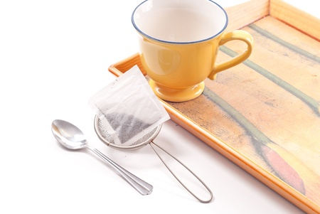 caffeinated: Tea Bag in Strainer with Tea Spoon Stock Photo